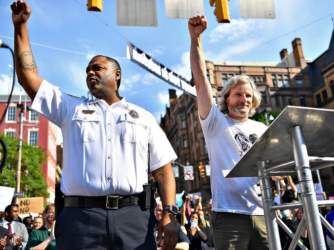 York City Police Commissioner Osborne Robinson, left, and York City Mayor Michael Helfrich stand together as more than 1,000 participate in the York Black Lives Matter Peaceful Protest in York City, Tuesday, June 2, 2020. It would be the second day of larger scale protests in the city following the death of George Floyd, a Minnesota man who died in police custody in Minneapolis, Mn., on May 25. Dawn J. Sagert photo