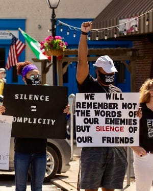 University of Maryland graduate and former football team captain Ellis McKennie, right, joined a protest in Hanover on Sunday alongside his sister, Ava McKennie. The George Washington Law School student is from McSherrystown.