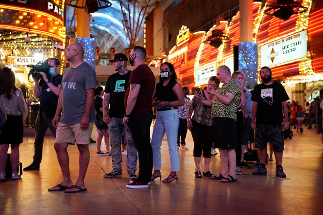 People wait in line to enter a casino on June 4, 2020, the date that marked the reopening of Nevada's gaming industry during the COVID-19 pandemic.