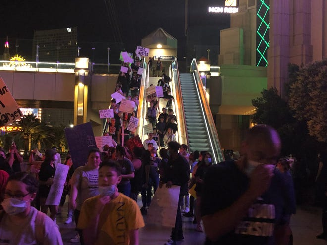 Protestors finish their main march down the escalators near the MGM Grand.