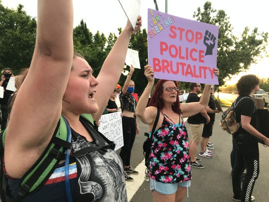 Sam Hewitt, left, said she was part of a new generation to change the world and put a stop to police brutality against black people.