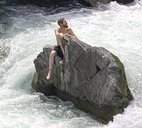 Matthew Ramey, 38, of Red Bluff found himself stuck on a large rock in the middle of Clear Creek and numerous agencies responded to rescue him Wednesday, June 3, 2020.