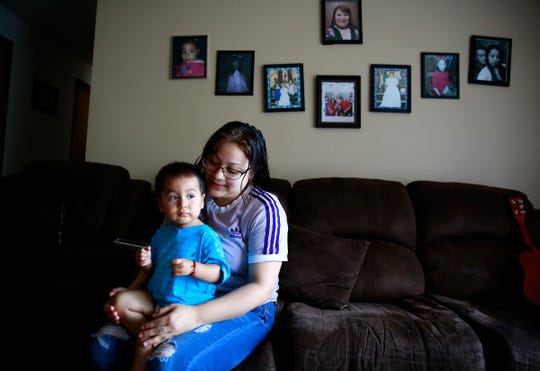 Perla Hernandez, 18, sits with her 19-month-old son Matias in her home in Salem, Oregon, on Wednesday, June 3, 2020. She is graduating from the Roberts High School Teen Parent Program this year.
