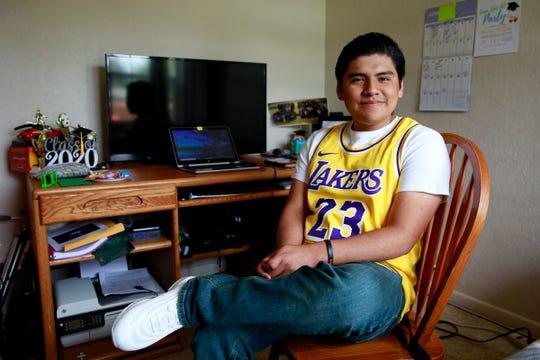 McKay High School graduating senior Ismael Hernandez, 17, completed his final year doing classwork in his bedroom in Keizer, Oregon, on Wednesday, June 3, 2020.