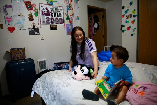 Perla Hernandez, 18, sits with her 19-month-old son Matias in her home in Salem, Oregon, on Wednesday, June 3, 2020. She is graduating from the Roberts High School Teen Parent Program this  had to juggle classwork and taking care of her son after in-person classes were canceled for the school year due to the pandemic.