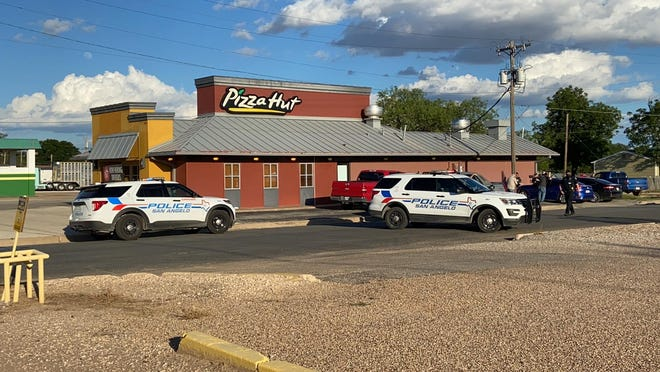 Officers with the San Angelo Police Department investigate a shooting at a Pizza Hut in the 1700 block of Pulliam Street. June 3, 2020.