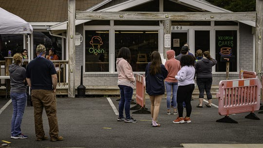 Take-out only didn't stop a line from forming at Island Creamery on Chincoteague after the popular shop opened.