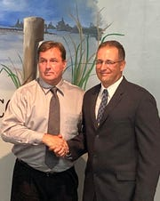 Crisfield Mayor Barry Dize, left, welcomes new Police Chief David Dalfonso.