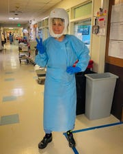 Sioux Falls native Amy Hindbjorgen wears full personal protective equipment while working as a traveling critical care nurse at Harborview Medical Center in Seattle.