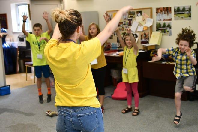 Marissa Hall rehearses with children's choir kids in 2019