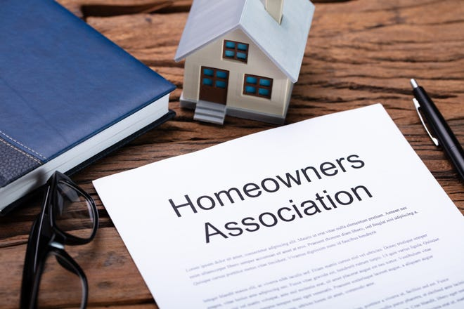 House Model Near HOA Rules And Regulations Document