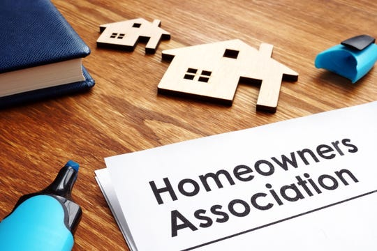 What is the law on property owner signatures for updating an HOA's CC&R?