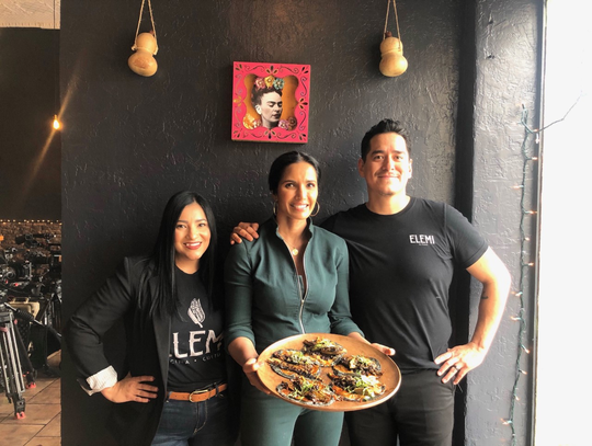 """Padma Lakshmi, center, visited with Kristal and Emiliano Marentes at their restaurant Elemi for her new Hulu show, """"Taste the Nation."""""""