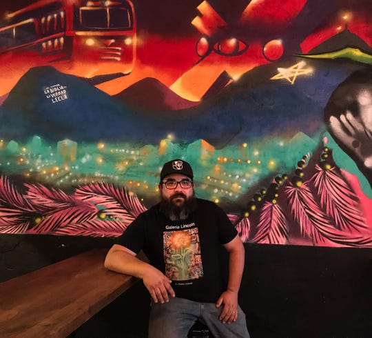 Old Sheepdog Brewery owner and master brewer Gus Delgado sits in front of one of the murals that decorate the walls, both inside and outside, on May 28, 2020.