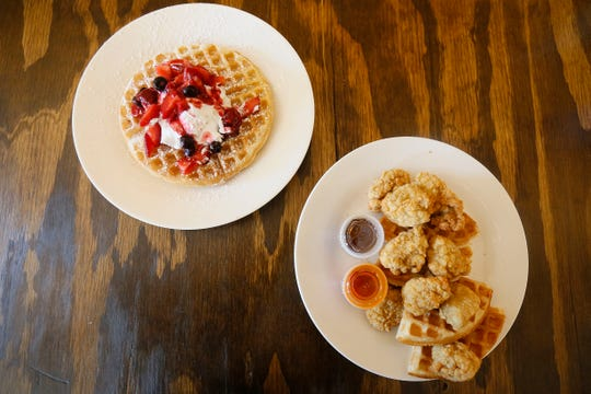 Berry waffles and chicken and waffles are shown at Coffee Waffle on Thursday, June 4, 2020, in Clint, Texas. Coffee Waffle opened in late February.