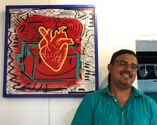 El Paso artist and Galeria Lincoln co-owner Diego Martinez stands before one of his artworks at the gallery at 3915 Rosa Ave. on Thursday, May 28, 2020.