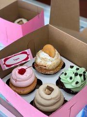 Vegan and regular cupcakes are boxed to go at Missy's Cupcake Creations in Ventura. The business also offers vegan and regular doughnuts.