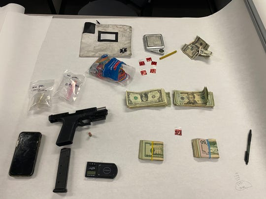 Oxnard police said they seized a large amount of cash, a 9 mm gun, a high-capacity magazine and drugs after a traffic stop Thursday morning.