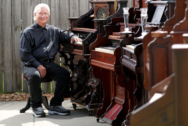 Navy veteran Michael J. Kennally, who started collecting old Victorian-era pump organs about a decade ago, is seen in his Milwaukee driveway on May 27, 2020, with a portion of his pump organs from the 1880s. Kennally, 63, suffers from a degenerative back problem that forces him to use a wheelchair at times, and is a survivor of prostrate cancer that he had two years ago. After he fought and won to live and keep his organs at the Jehovah's Witnesses Kingdom Hall in Marshfield, Kennally will be moving himself and his organs in the coming weeks.