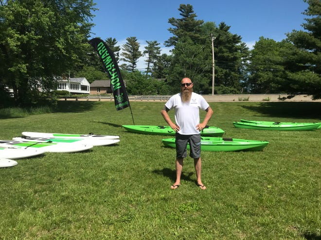 Patrick Gatterman stands near his kayaks available for rent through Northward Peddle & Paddle