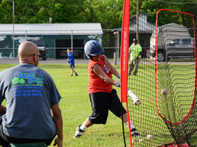 Karter Burrell, of the Muskingum County Muck Dogs 10-and-under team, participates in a soft toss drill at the Y-City Midget Baseball diamonds in Zanesville. Twenty teams from Muskingum County played at Y-City this year after multiple organizations chose not to have a season.
