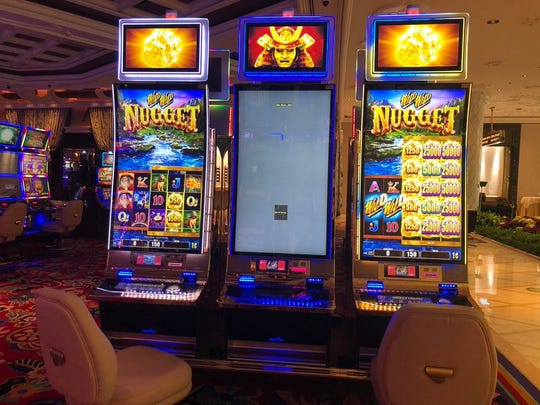 At the Wynn Las Vegas, slot machines are set up for social distancing with middle machinesout of service to separate gamblers in the name of social distancing.