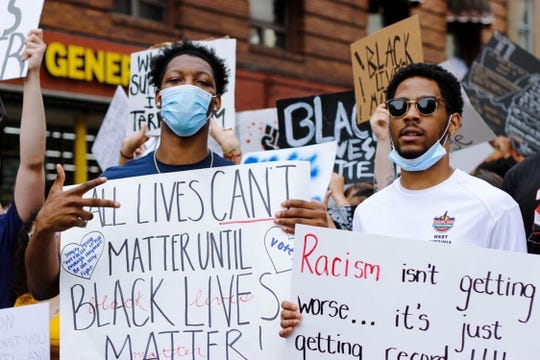 Gabe Osabuohien attended a protest in Morgantown, West Virginia, on Tuesday.