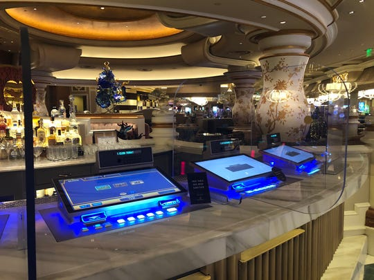 Bellagio has doubled down on coronavirus precautions with partitions separating video poker machines, blackjack and poker tables.
