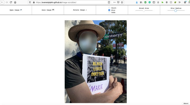 "Jennifer's husband at a peaceful protest in Oakland, California this week. This is the ""after"" shot, using Image Scrubber to blur his face."