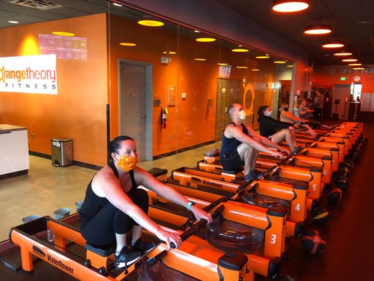 "Classes at reopened Orangetheory studios are held at limited capacity to allow for social distancing. The classes are now ""mask optional."""