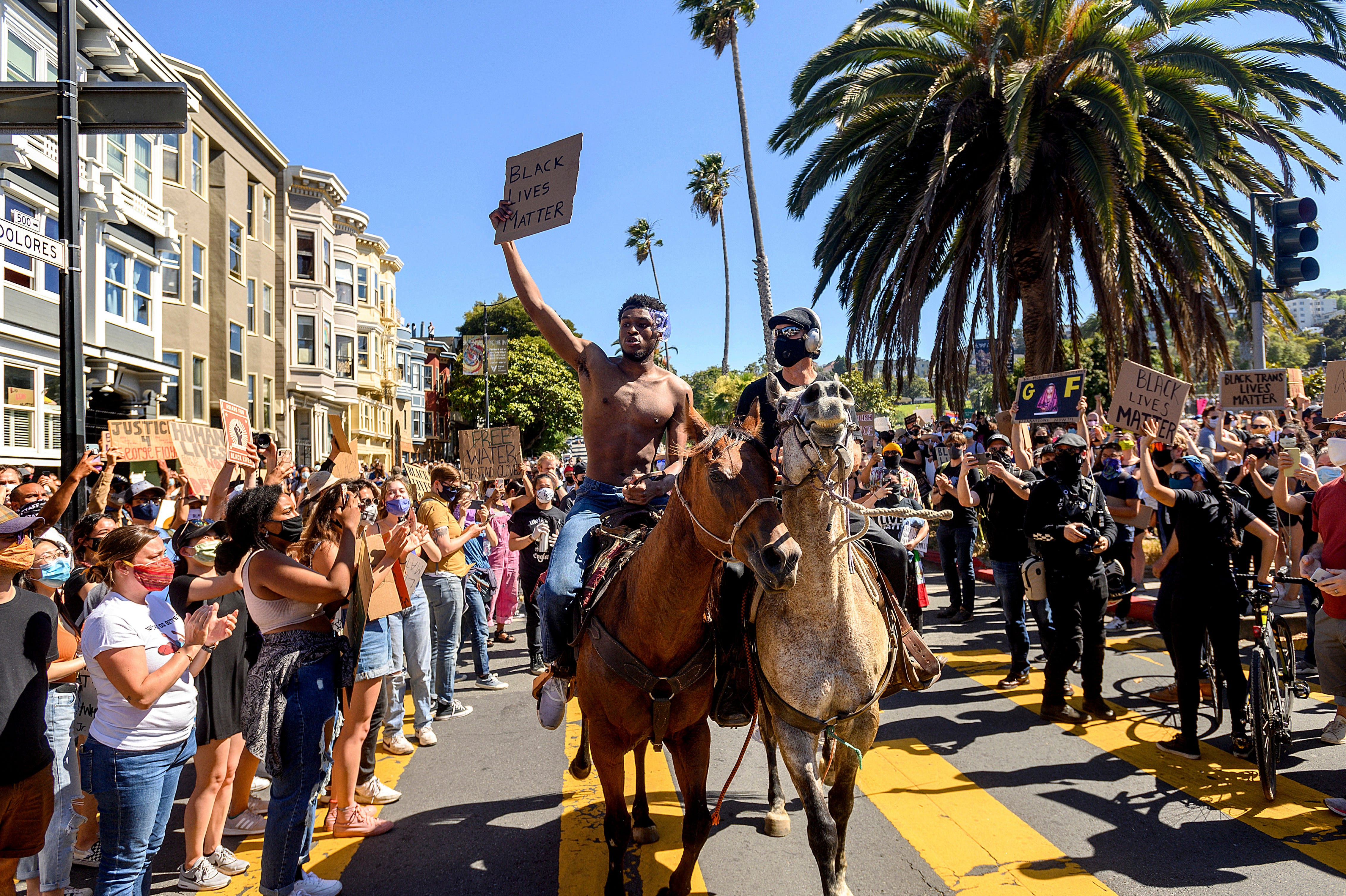 George Floyd protests: 10K march in San Francisco; Floyd s son visits site of father s death; New York City, Los Angeles continue curfew