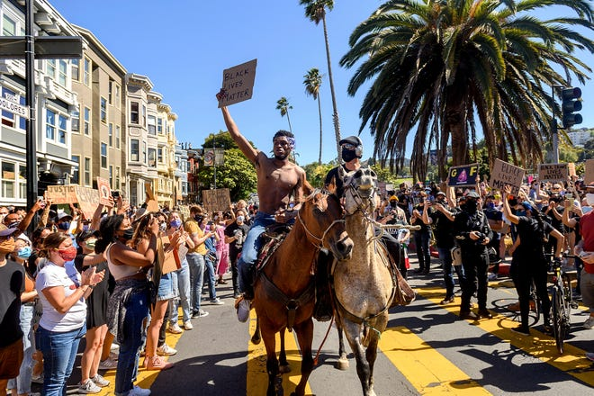 Demonstrators rally in San Francisco's Mission District on Wednesday to protest the death of George Floyd in Minneapolis.