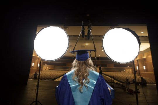 Madison Voinovich, the first valedictorian of the new Olentangy Berlin High School, should have addressed her class center stage from the Schottenstein Center on Ohio State's campus, but instead, she records her valedictorian speech for a film crew in an empty school auditorium, Tuesday, June 2, 2020.