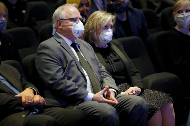 Minnesota Gov. Tim Walz, here attending a memorial for George Floyd with his wife Gwen, said Thursday he endorses a package of police reforms in the state.