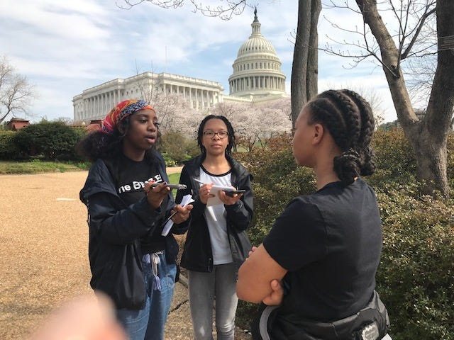 Eve Ellis and Alana Campbell, both high school students in the Washington Association of Black Journalists Urban Journalism Workshop, interview visitors and protesters outside the U.S. Capitol. The program led by professional journalists aims to prepare students for careers in the journalism business.