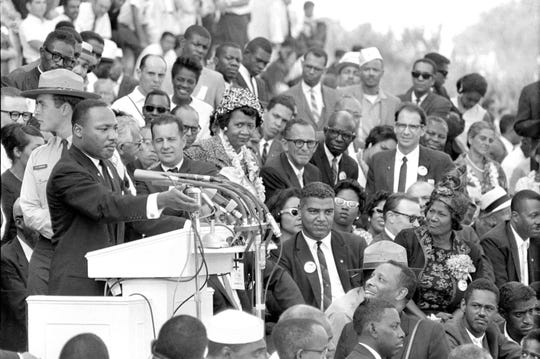 """Martin Luther King Jr., head of the Southern Christian Leadership Conference, addresses thousands of civil rights supporters gathered in front of the Lincoln Memorial for the March on Washington on Aug. 28, 1963.  Actor-singer Sammy Davis Jr., lower right, was there for King's """"I Have a Dream"""" speech."""