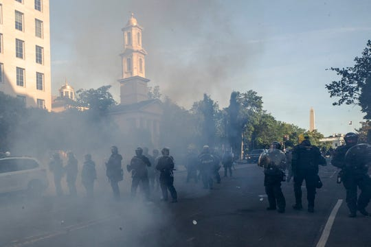 Police move demonstrators away from St. John's Church across Lafayette Square near the White House on June 1 in Washington.