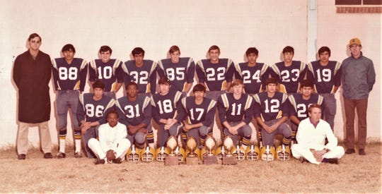 C.H. Underwood, right, poses with his O'Brien team that won the first six-man football state title in 1972. The Bulldogs mercy ruled Jarrell in the title game.