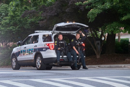 Police patrol after curfew following a peaceful vigil in downtown Asheville on June 4, 2020 in response to the May 25 death of George Floyd at the hands of Minneapolis police. Protesters abided by the emergency city curfew of 8 p.m. and left without police intervention.