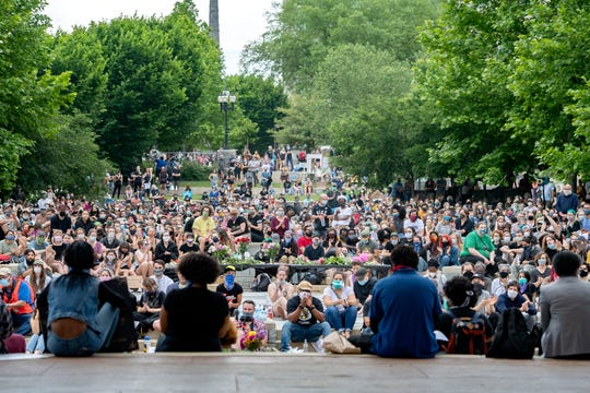 About one thousand people gathered for a peaceful vigil in downtown Asheville on June 4, 2020 in response to the May 25 death of George Floyd at the hands of Minneapolis police. Protesters abided by the emergency city curfew of 8 p.m. and left without police intervention.