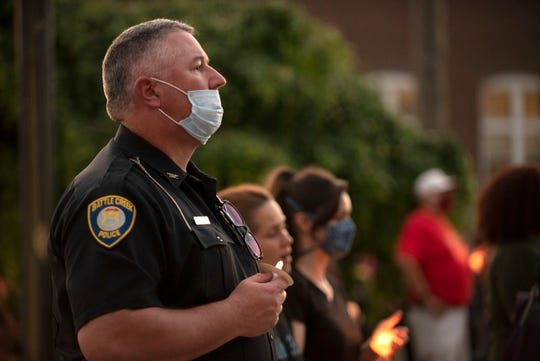 Deputy Chief Jim Grafton attends candlelight vigil for Ahmaud Arbery, George Floyd and Breonna Taylor on Thursday, June 4, 2020 at the Calhoun County Justice Center in Battle Creek, Mich.