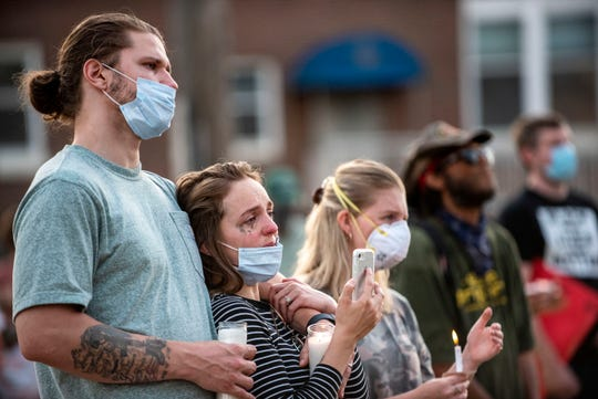 Daniel and Savanah Birmingham attend a candlelight vigil for Ahmaud Arbery, George Floyd and Breonna Taylor on Thursday, June 4, 2020 at the Calhoun County Justice Center in Battle Creek, Mich.