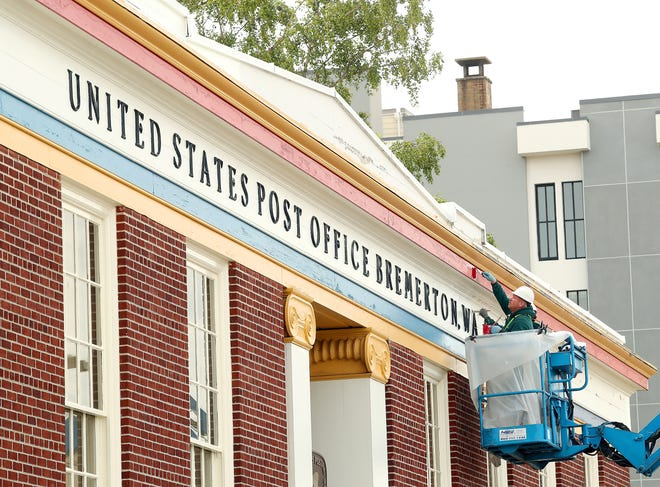 A crew from Abco Contracting, a Wisconsin-based company, repaints the exterior of the U.S. Post Office in downtown Bremerton on Friday, June 5, 2020.