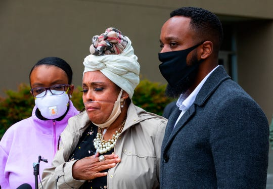 Marcia Carter-Patterson, center, mother of Manny Ellis, speaks at a press conference in front of the Pierce County Superior Court in Tacoma Thursday, June 4, 2020 regarding the killing of her son by Tacoma police. At left is Manny's sister Monet Carter-Mixon and at right is his brother Matthew Ellis.
