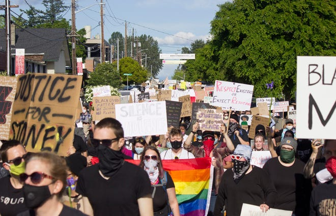 Protesters march through downtown Winslow on Thursday.