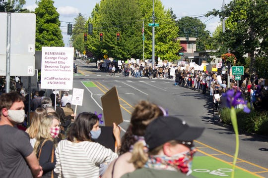 Protesters line Winslow Way on Thursday.