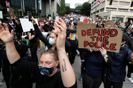 Demonstrators march toward Seattle City Hall Wednesday, June 3, 2020, in Seattle, following protests over the death of George Floyd, a black man who died in police custody in Minneapolis.