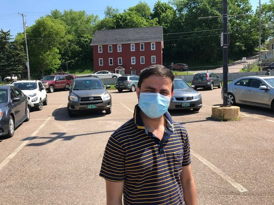 Puru Nepal waits in line at Winooski's pop-up coronavirus clinic on Friday, June 5, 2020.