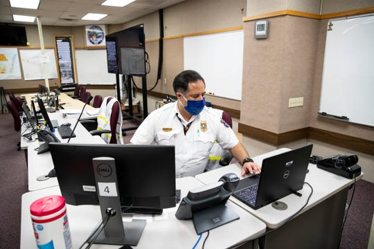 Corpus Christi Deputy Fire Chief sits inside the emergency operations center as City Manager Peter Zanoni is given a tour on Thursday, June 4, 2020.