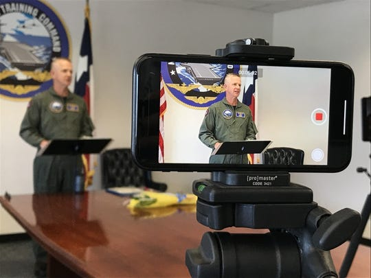 Rear Adm. Daniel Dwyer addresses a virtual audience before relinquishing command as Chief of Naval Air Training to Rear Adm. Robert Westendorff during a ceremony at CNATRA headquarters aboard Naval Air Station Corpus Christi, June 5. The ceremony was limited to immediate family in accordance with Centers for Disease Control and Prevention, Department of Defense, and Navy COVID-19 spread mitigation guidelines. CNATRA is responsible for training the world's finest combat-quality aviation professionals, delivering them at the right time, in the right numbers, and at the right cost to a naval force that is where it matters, when it matters.